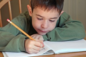 boy writing at Bexley City Schools