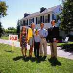 Family Posing Outside their New House