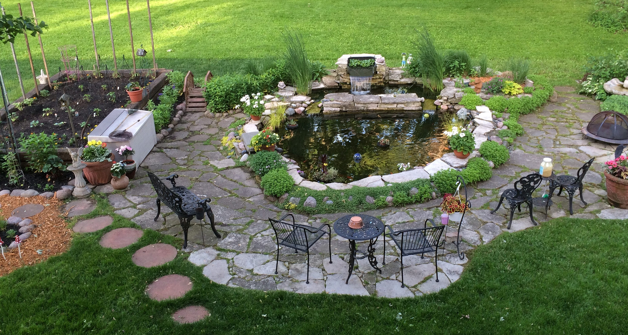 7 tips for caring for a yard with acreage the columbus for Backyard pond animals