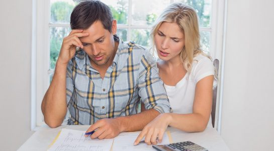 Advice for First Time Home Buyers - couple reviewing finances