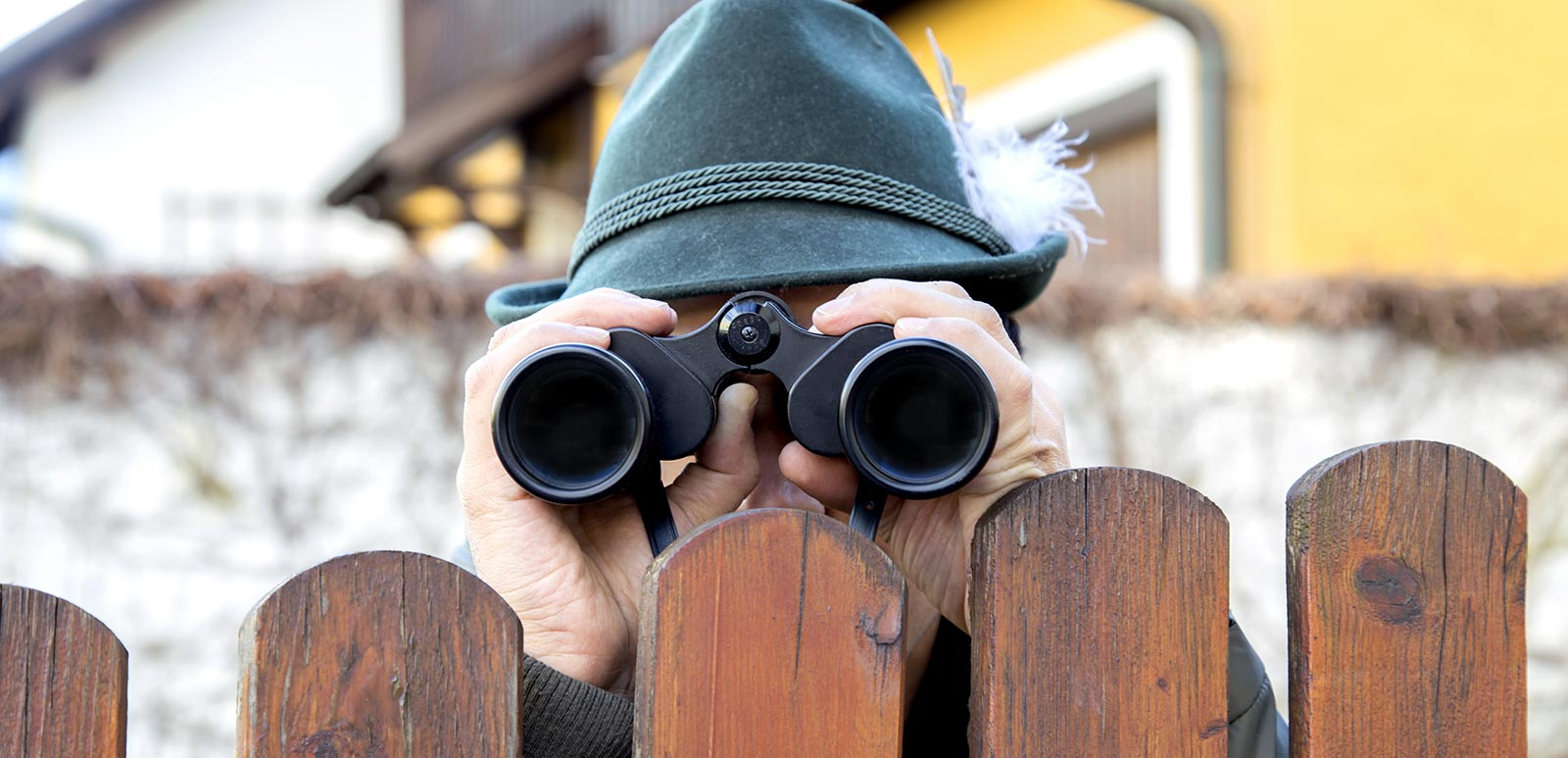 10 Tips for Keeping Our Neighborhoods Safe - Man with binoculars peering over fence