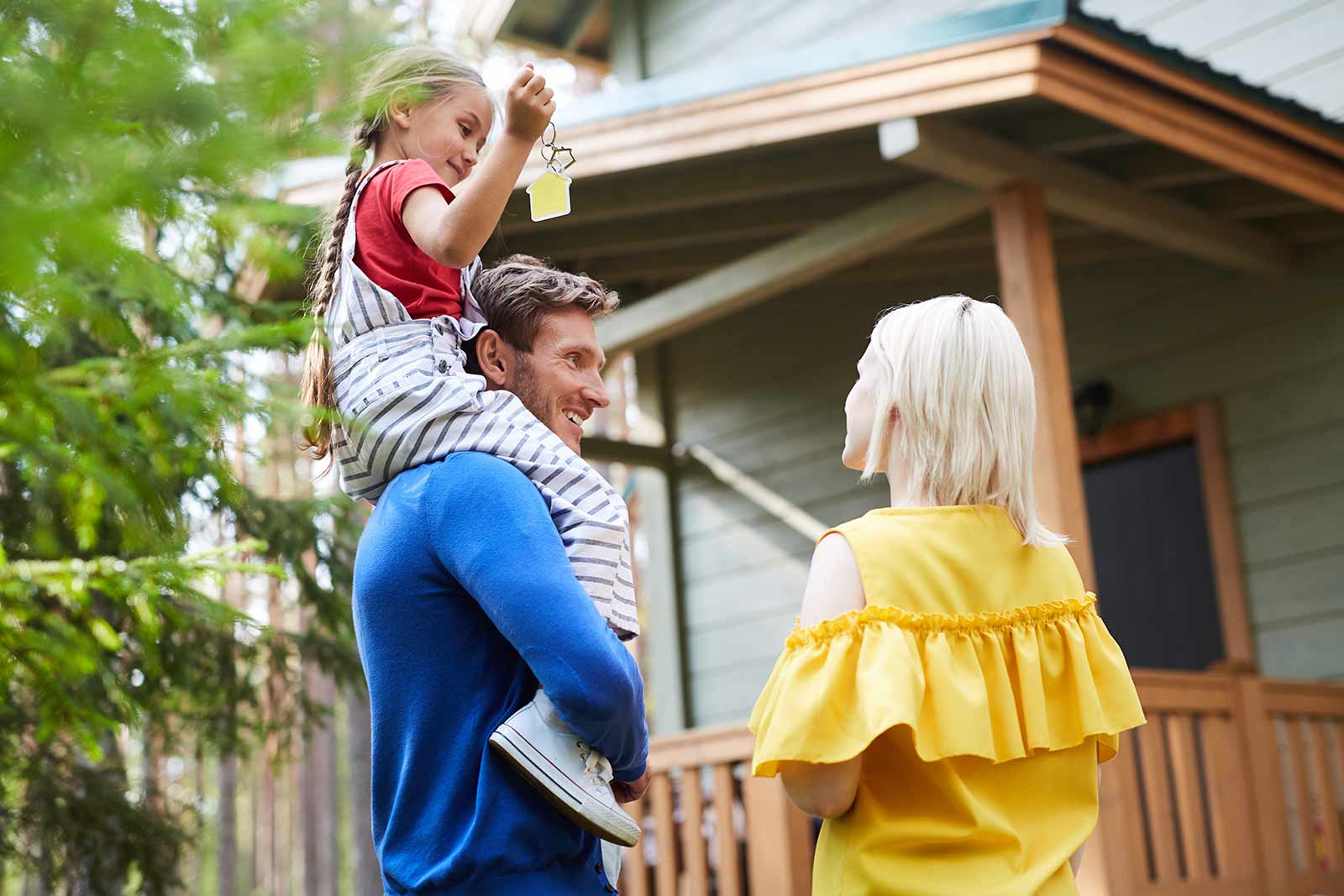 Finding the right house for your family: family in front of house