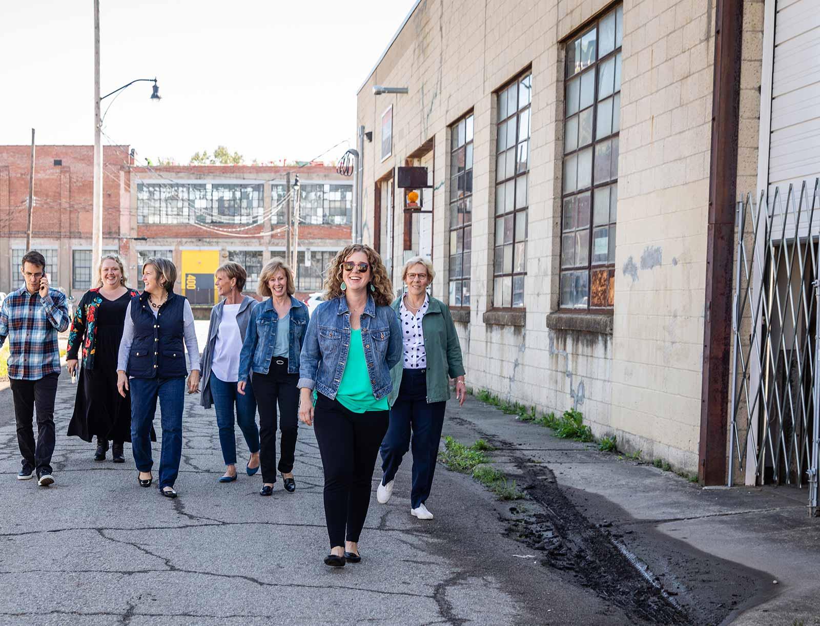 The Columbus Team walking down a Columbus street